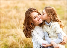 Mother and daughter hugging in love playing in the park Stock Image