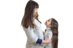Mother and daughter hugging and smiling to each other Stock Image