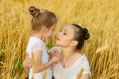 Mother and daughter hugging in wheat Stock Photo