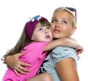 Mother daughter hugging stock photos