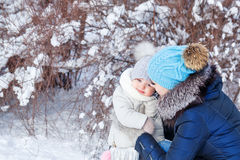 Mother and daughter hugging in the winter. stock images