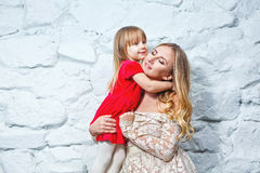 Mother and daughter hugging Stock Images