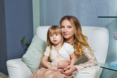 Mother and daughter hugging Stock Photos