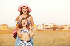 Mother and daughter with ice cream stock photography