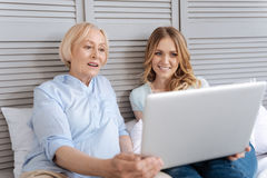Mother and daughter immersed into watching video Royalty Free Stock Photography