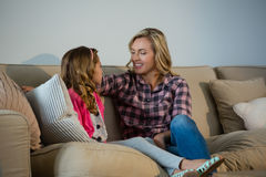 Mother and daughter interacting with each other in the living room. At home Royalty Free Stock Photography
