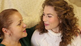 Mother and daughter are intimate conversation.