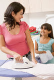 Mother And Daughter Ironing Royalty Free Stock Image