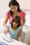 Mother And Daughter Ironing Royalty Free Stock Images