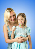 Mother with daughter isolated on white Stock Images