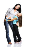 Mother with daughter isolated on white background. Studio shot with mirroring Royalty Free Stock Photos
