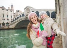 Mother and daughter with Italian flag near Ponte di Rialto Stock Images