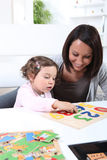 Mother and daughter with a jigsaw Royalty Free Stock Image