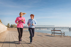 Mother and daughter jogging Stock Image