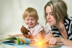 Mother and daughter in a joint game Stock Photography