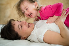 Mother with daughter - joyous moments Royalty Free Stock Image