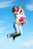 Mother and daughter jumping Royalty Free Stock Photography