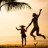 Mother and  daughter jumping at the beach Royalty Free Stock Photo