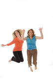 Mother and daughter jumping for joy. Isolated on white Stock Photos