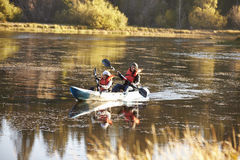 Mother and daughter kayaking together on a lake, front view Royalty Free Stock Images