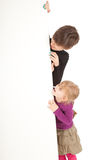 Mother and daughter keeping blank poster Stock Photos