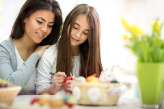 Mother and daughter kid paint Easter eggs Royalty Free Stock Photography