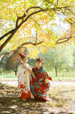 Mother and daughter in a kimono walking in the Park Stock Photography