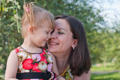 Mother and daughter kissing and happy Stock Photo