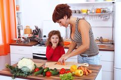 Mother and daughter in the kitchen royalty free stock photography