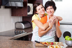 Mother daughter in kitchen Royalty Free Stock Images