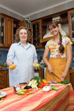 Mother with daughter in the kitchen Stock Photo