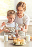 Mother and daughter in the kitchen Royalty Free Stock Photo