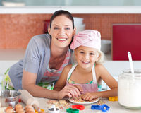 Mother and daughter Kitchen Smiling at Camera Stock Image