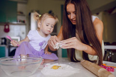 Mother and daughter in the kitchen Stock Image