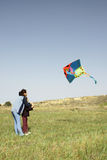 Mother and daughter with kite Royalty Free Stock Images