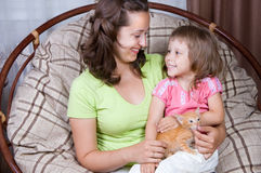 Mother and daughter and the kitten Stock Photography