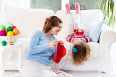 Mother and daughter knitting woolen scarf Royalty Free Stock Image