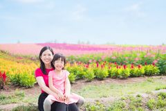 Mother and daughter with landscape stock photography