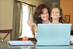 Mother and daughter with laptop Stock Photo