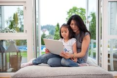 Mother and daughter with laptop Royalty Free Stock Images