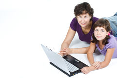 Mother and daughter with laptop Royalty Free Stock Photography
