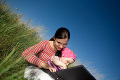 Mother and daughter with laptop Stock Images