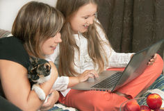 Mother and daughter with laptop Stock Photography