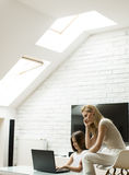 Mother with a daughter on the laptop at home Stock Image