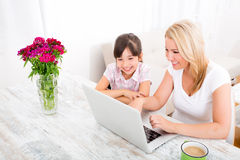 Mother and Daughter with a Laptop at home Royalty Free Stock Photos