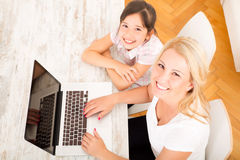 Mother and Daughter with a Laptop at home Stock Photo