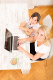 Mother and Daughter with a Laptop at home Stock Photos