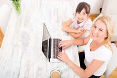 Mother and Daughter with a Laptop at home Royalty Free Stock Images