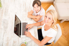 Mother and Daughter with a Laptop at home Stock Photography