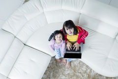 Mother and daughter with laptop at home Royalty Free Stock Photography